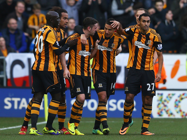 Jake Livermore of Hull City celebrates the opening goal with team mates during the Barclays Premier League match between Hull City and Liverpool at KC Stadium on December 1, 2013