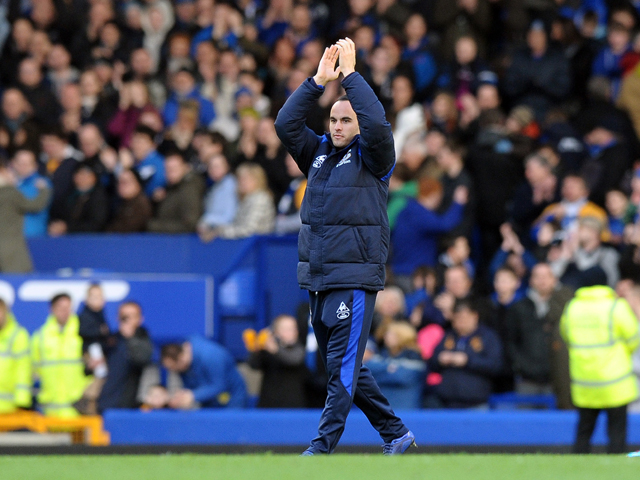 Everton's US midfielder Landon Donovan waves to the crowd as his loan spell comes to an end after the English FA Cup 5th Round football match between Everton and Blackpool at Goodison Park in Liverpool, north-west England on February 18, 2012