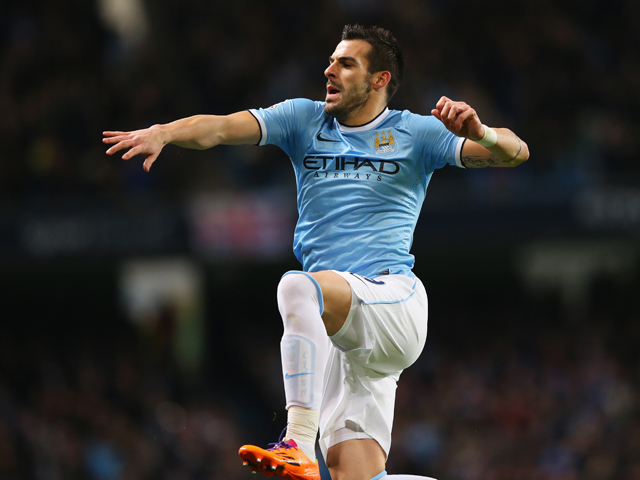 Alvaro Negredo of Manchester City celebrates scoring the opening goal during the Barclays Premier League match between Manchester City and Swansea City at Etihad Stadium on December 1, 2013