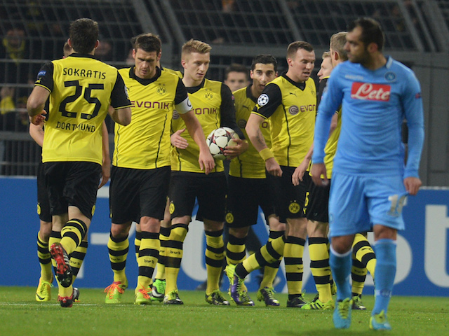 Dortmund's striker Marco Reus celebrates scoring with his teammates during the UEFA Champions League Group F football match against Napoli on November 26, 2013
