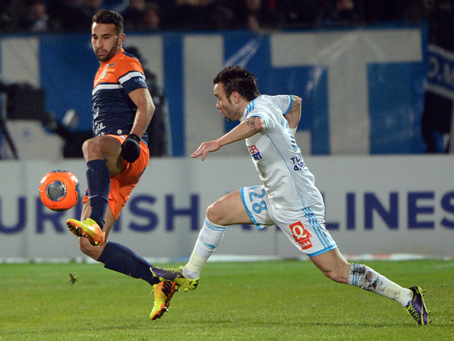 Montpellier's Moroccan defender Abdelhamid El-Kaoutari vies with Marseille's French midfielder Mathieu Valbuena on November 29, 2013