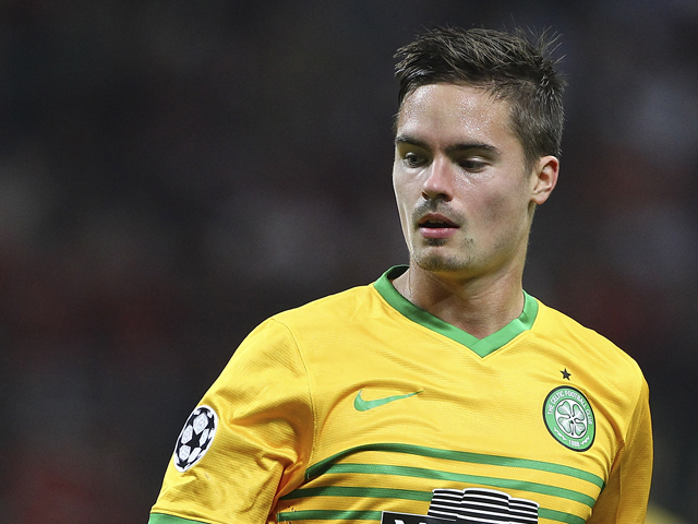 Mikael Lustig of Celtic looks on during the UEFA Champions League group H match between AC Milan and Celtic at Stadio Giuseppe Meazza on September 18, 2013