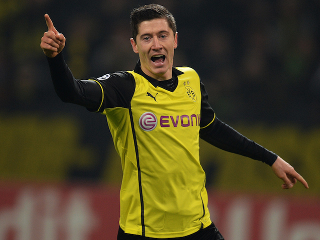 Dortmund's Polish striker Robert Lewandowski celebrates after the 3-1 goal during the UEFA Champions League Group F football match against SSC Napoli on November 26, 2013