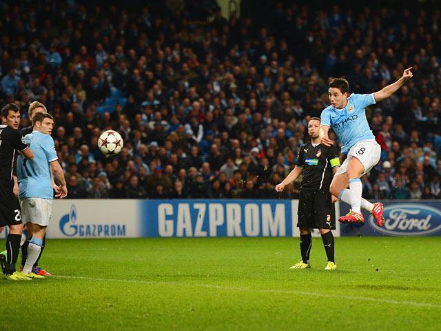 Man City's Samir Nasri scores his team's second goal against Viktoria Plzen during their Champions League group match on November 27, 2013