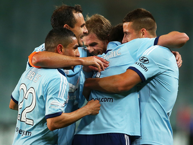 Ranko Despotovic of Sydney celebrates with team mates after scoring a goal during the round eight A-League match between Sydney FC and the Newcastle Jets at Allianz Stadium on November 30, 2013
