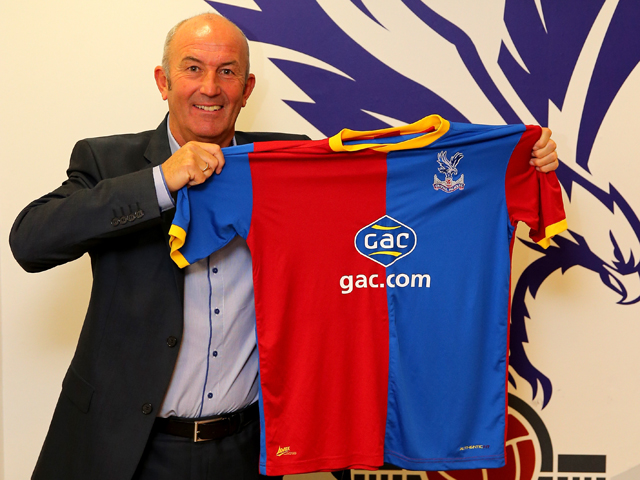 Tony Pulis poses with a team shirt after being unveiled as the new Crystal Palace Manager on November 25, 2013