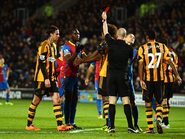 Yannick Bolasie of Crystal Palace is shown the red card by referee Anthony Taylor during the Barclays Premier League match between Hull City and Crystal Palace at KC Stadium on November 23, 2013