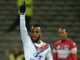 Lyon's French forward Alexandre Lacazette reacts after scoring during the French Ligue 1 football match against Toulouse FC on December 5, 2013