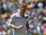 England's paceman Ben Stokes approaches his bowling mark against Australia during day two of the second Ashes Test cricket match in Adelaide on December 6, 2013