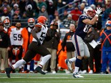 Rob Gronkowski #87 of the New England Patriots catches a pass before being hit by T.J. Ward #43 and D'Qwell Jackson #52 of the Cleveland Browns in the third quarter during the game at Gillette Stadium on December 8, 2013