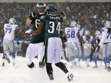 Running back Bryce Brown #34 of the Philadelphia Eagles is congratulated by teammate offensive tackle Lane Johnson #65 after scoring a two point conversion after a touchdown in the fourth quarter during against the Detroit Lions a game at Lincoln Financia