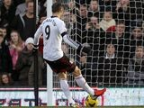 Fulham's Dimitar Berbatov scores his team's second goal via the penalty spot against Aston Villa during their Premier League match on December 8, 2013