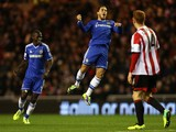 Chelsea's Eden Hazard celebrates after scoring his team's second goal against Sunderland during their Premier League match on December 4, 2013