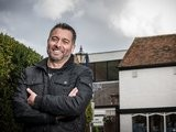 Spanish journalist Guillem Balague poses for a photograph, taken by John Quintero.