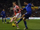 Cardiff's Steven Caulker and Stoke's Peter Crouch in action during their Premier League match on December 4, 2013