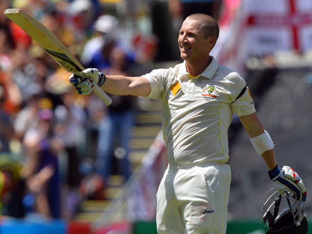 Australian batsman Brad Haddin celebrates scoring a century against England during day two of the second Ashes Test cricket match in Adelaide on December 6, 2013