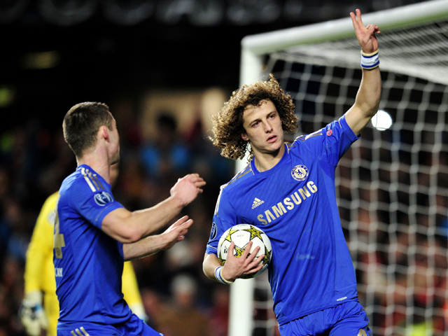 Chelsea's Brazilian defender David Luiz celebrates scoring a penalty during their UEFA Champions League group E football match against FC Nordsjaelland at Stamford Bridge, London on December 5, 2012