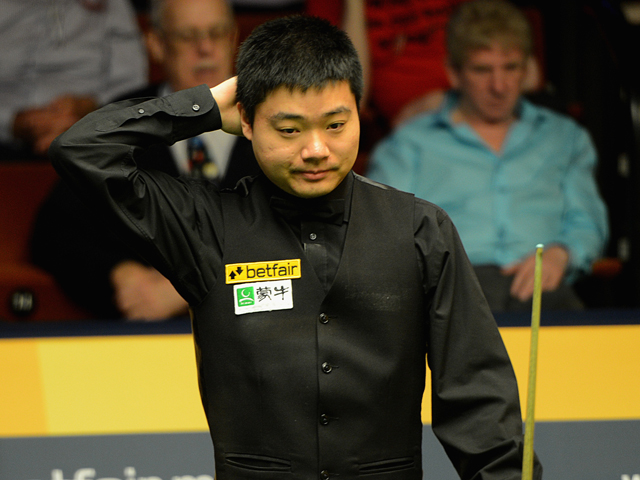 Ding Junhui of China looks on in his match against Barry Hawkins of England during the Betfair World Snooker Championship at the Crucible Theatre on April 30, 2013
