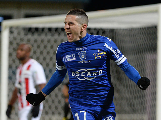 Bastia's Florian Raspentino celebrates after scoring the opening goal against Ajaccio during their Ligue 1 match on December 4, 2013