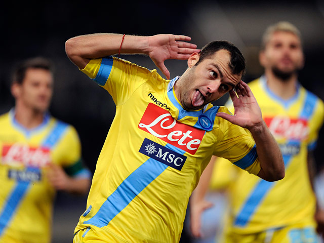 Napoli's Goran Pandev celebrates after scoring his team's second goal against Lazio during their Serie A match on December 2, 2013