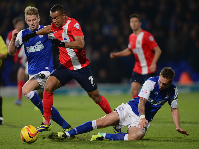 Joshua King of Blackburn battles with Luke Chambers and Luke Hyman of Ipswich during the Sky Bet Championship match on December 3, 2013
