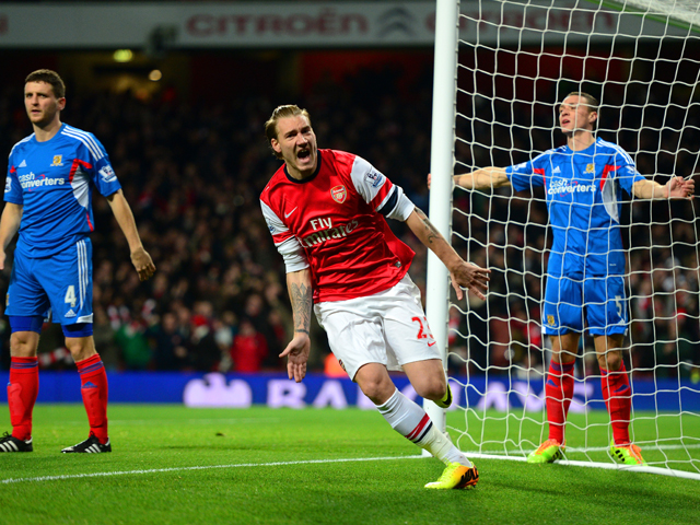 Nicklas Bendtner of Arsenal celebrates scoring the opening goal during the Barclays Premier League match between Arsenal and Hull City at Emirates Stadium on December 4, 2013