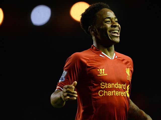 Liverpool's Raheem Sterling celebrates after scoring his team's fifth goal against Norwich during their Premier League match on December 4, 2013