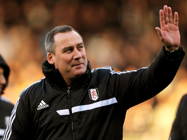 Rene Meulensteen the Fulham head coach waves to the fans prior to kickoff during the Barclays Premier League match between Fulham and Swansea City at Craven Cottage on November 23, 2013