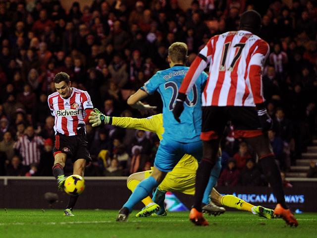 Adam Johnson of Sunderland scores the opening goal during the Barclays Premier League match between Sunderland and Tottenham Hotspur at Stadium of Light on December 07, 2013