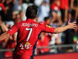 Jeronimo Neumann of Adelaide United celebrates after scoring their fourth goal during the round 10 A-League match between Adelaide United and the Central Coast Mariners at Coopers Stadium on December 14, 2013