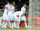 Monaco's French forward Anthony Martial celebrates with teammates after scoring a goal during the French L1 football match between Guingamp and Monaco on December 14, 2013