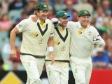 Shane Watson, Michael Clarke and Brad Haddin of Australia celebrate as they win the match during day five of Second Ashes Test Match between Australia and England at Adelaide Oval on December 9, 2013
