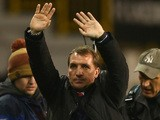 Manager Brendan Rodgers of Liverpool waves to the fans at the final whistle during the Barclays Premier League match against Tottenham Hotspur on December 15, 2013