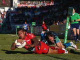 David Smith of Toulon scores his second try despite the attentions of Luke Arscott of Exeter Chiefs during the Heineken Cup Pool Two match on December 14, 2013