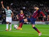 Gerard Pique of FC Barcelona scores the opening goal during the UEFA Champions League Group H match between FC Barcelona and Celtic FC at Camp Nou on December 11, 2013