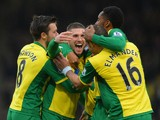 Gary Hooper of Norwich celebrates scoring their first goal with team mates during the Barclays Premier League match between Norwich City and Swansea City at Carrow Road on December 15, 2013