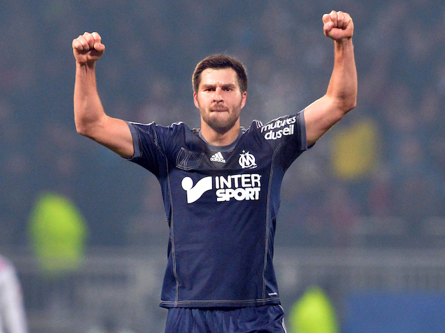 Marseille's French forward Andre-Pierre Gignac celebrates after scoring during the French L1 football match between Lyon (OL) and Marseille (OM) on December 15, 2013