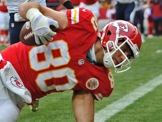 Tight end Anthony Fasano of the Kansas City Chiefs leans over the goal line for a touchdown against the San Diego Chargers during the second half on November 24, 2013