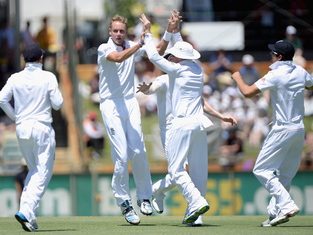 Stuart Broad of England celebrates with teammates after dismissing Mitchell Johnson of Australia during day two of the Third Ashes Test Match between Australia and England at WACA on December 14, 2013