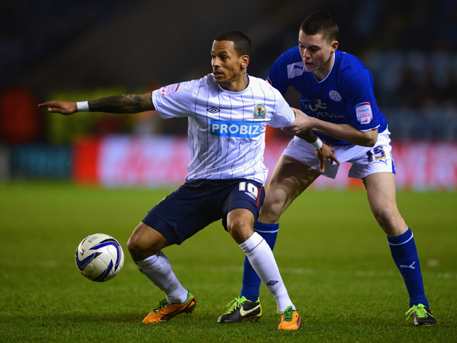 DJ Campbell of Blackburn battles Michael Keane of Leicester during the npower Championship match between Leicester City and Blackburn Rovers at The King Power Stadium on February 26, 2013