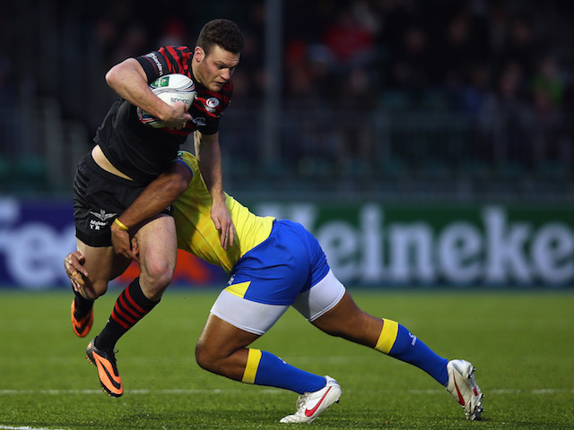 Duncan Taylor of Saracens is tackled by Samiu Vunisa of Zebre during the Heineken Cup Pool 3 round 4 match on December 14, 2013