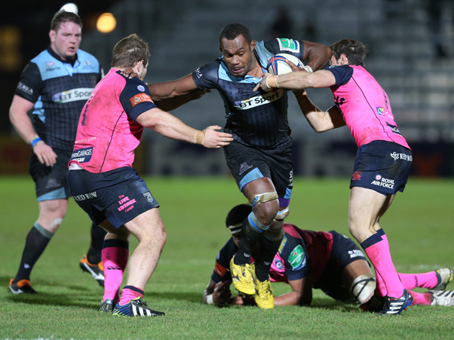Leone Nakarawa of Glasgow is tackled by Sam Hobbs of Cardiff and Gareth Davies of Cardiff during the The Heineken Cup Pool 2 Match between Glasgow Warriors and Cardiff Blues at Scotstoun Stadium, on December 13, 2013