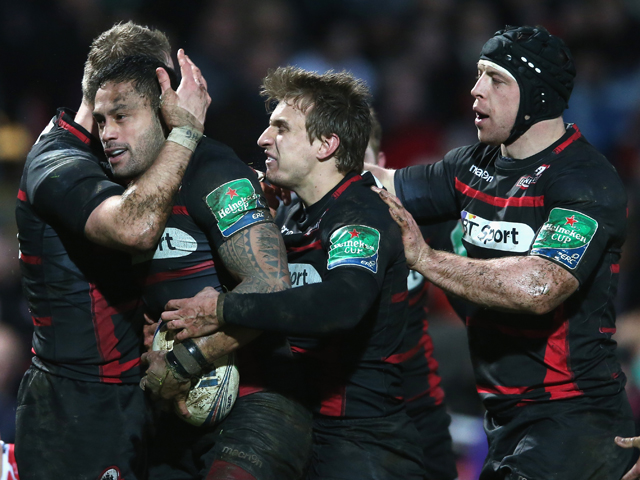 Ben Atiga of Edinburgh is congratulated by team mates after scoring a try during the Heineken Cup pool 6 match between Gloucester and Edinburgh at Kingsholm Stadium on December 15, 2013