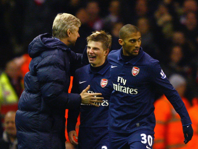 Andrey Arshavin of Arsenal celebrates scoring his team's second goal with Manager Arsene Wenger during the Barclays Premier League match between Liverpool and Arsenal at Anfield on December 13, 2009