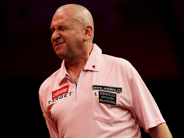 Mark Walsh of England reacts during his third round match against Wes Newton on day eleven of the 2013 Ladbrokes.com World Darts Championship at the Alexandra Palace on December 27, 2012