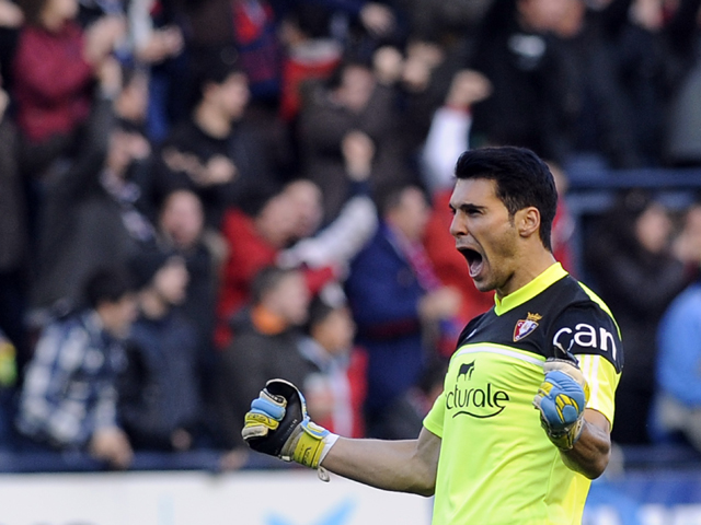 Osasuna's goalkeeper Andres Fernandez celebrates a goal during the Spanish league football match Osasuna vs Real Madrid at the Reyno de Navarra in Pamplona on December 14, 2013