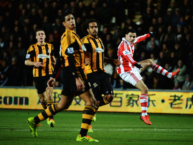 Oussama Assaidi of Stoke City shoots during the Barclays Premier League match between Hull City and Stoke City at KC Stadium on December 14, 2013