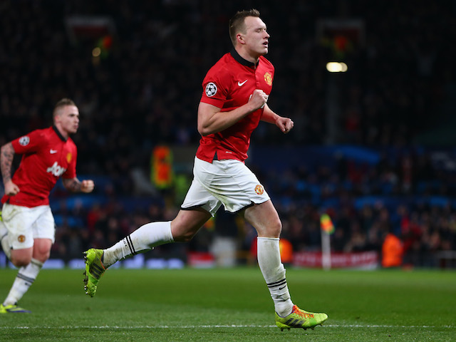 Phil Jones of Manchester United celebrates scoring the opening goal during the UEFA Champions League Group A match between Manchester United and Shakhtar Donetsk on December 10, 2013