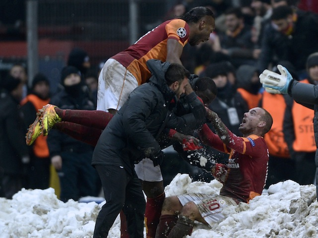 Didier Drogba jumps on Wesley Sneijder after the latter scored the winner for Galatasaray against Juventus in the Champions League on December 11, 2013
