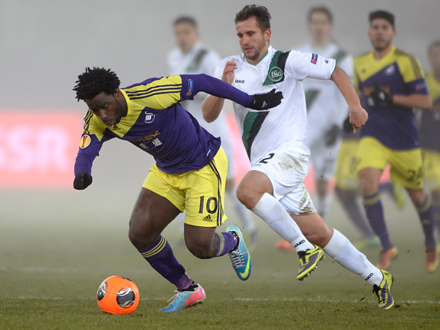 Swansea's Wilfried Bony and St Gallen's Muhamed Demiri in action during their Europa League group match on December 12, 2013